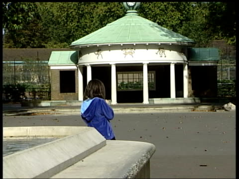 Smacking ban rejected by Commons ITN Coram's Field BV CBV Young girl standing alone beside fountain