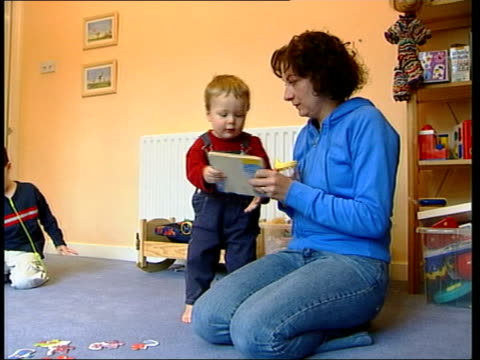 Smacking children is allowed in England Wales ITN Seq Mother playing on floor with four small children Liz Style interview SOT I don't like smacking/...