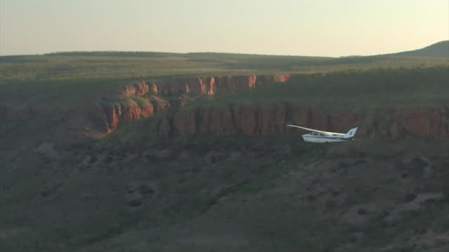 Small aircraft flying over the Kimberley lowlands, Western Australia. Editorial Use Only.