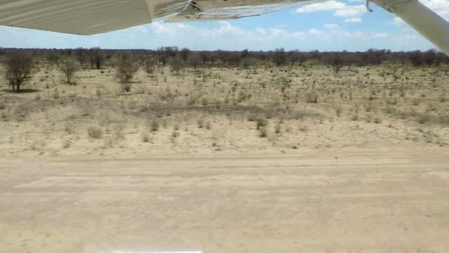 POV of small aircraft landing on Botswana airstrip/ Central Kalahari Game Reserve/ Botswana