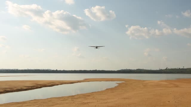 a small airplane flies above the tapajos river during a 'caravan of resistance'' protest by indigenous groups and supporters who oppose plans to... - para state stock videos & royalty-free footage