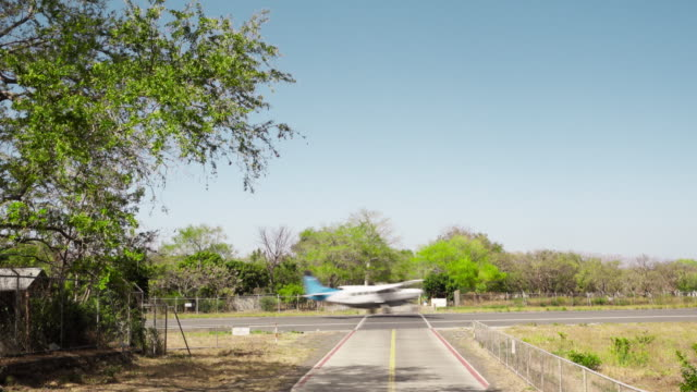 small airplane landing at tropical climate country road - nicaragua stock videos and b-roll footage