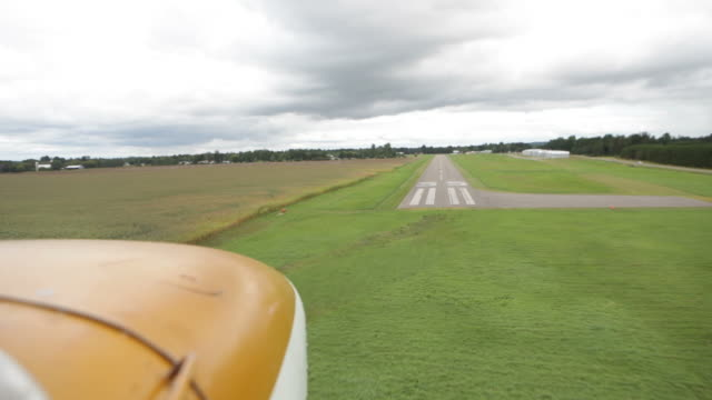 small airplane landing on a rural airport runway - airfield stock videos & royalty-free footage