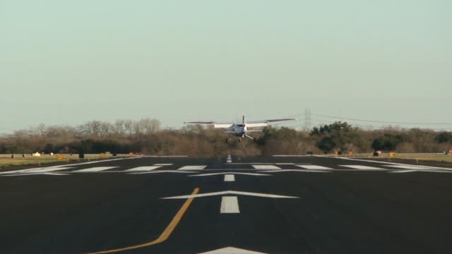 Small Airplane Landing On Runway