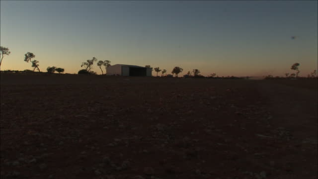stockvideo's en b-roll-footage met ws small airplane taking off from field at dawn, anna creek station, south australia, australia - anna creek station