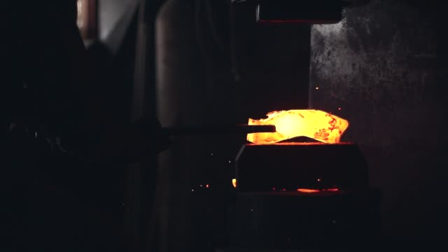 small black particles flying from hot  while getting forged - blacksmith stock videos & royalty-free footage