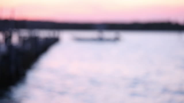 ws r/f small boat floating at fishing dock / oyster, virginia, usa - dissolvenza in chiusura video stock e b–roll