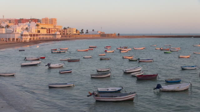 vidéos et rushes de small boat harbor with plenty of boats docked - bercement