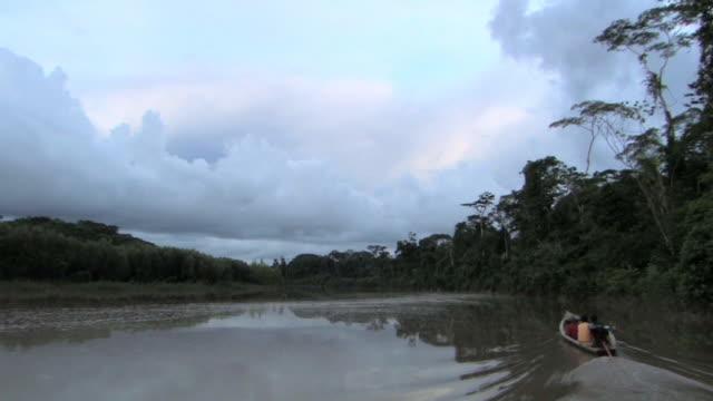 WS TS small boat on river/ Manu National Park, Peru