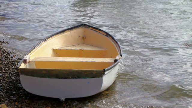 small boat rocking on the shore