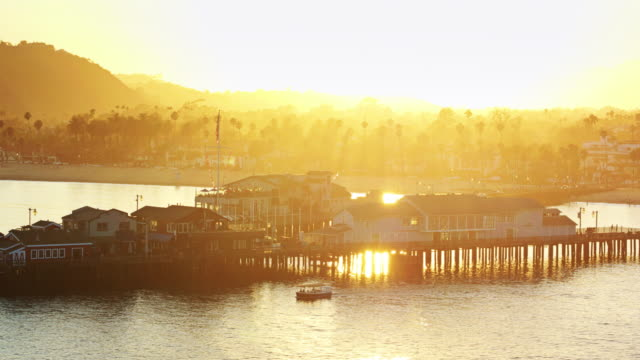 Small Boat Sailing Around Stearns Wharf, Santa Barbara - Drone Shot