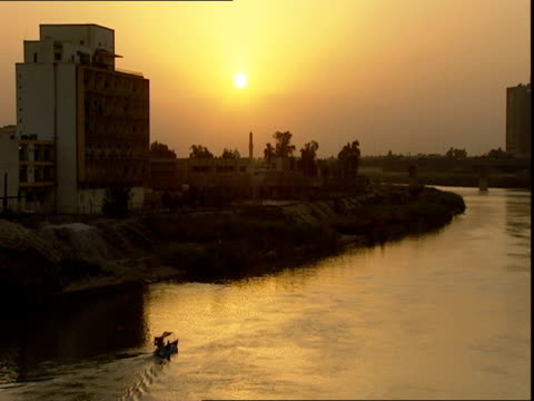 Small boat with canopy on Tigris River at sunset / Baghdad Iraq