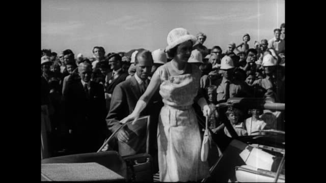 / small boats lined up along the shore of auckland for the royal regatta / queen elizabeth and prince philip look over the scene / crowds of... - 1963 stock videos & royalty-free footage
