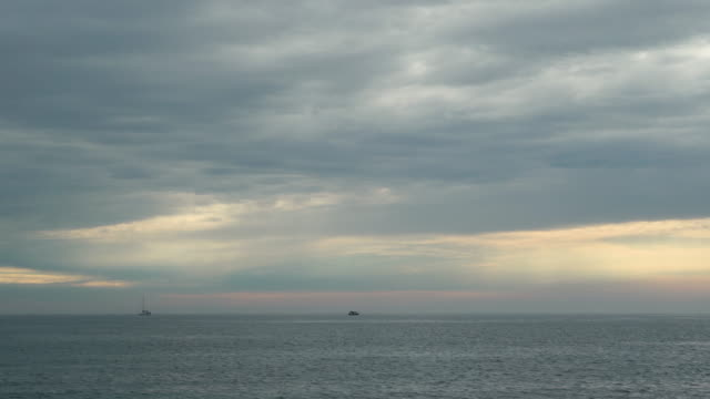 small boats on the sea on overcast day - horizon over water stock videos & royalty-free footage