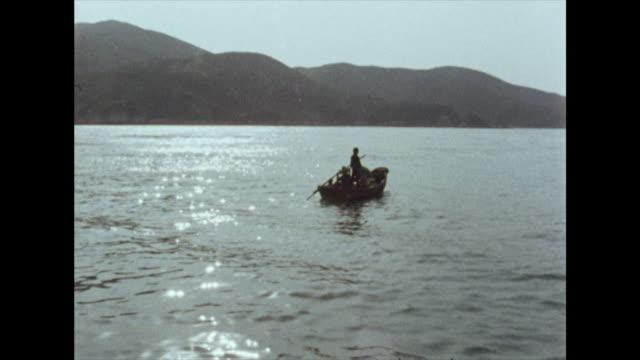 small boats on the water around hong kong; 1972 - hong kong stock videos & royalty-free footage
