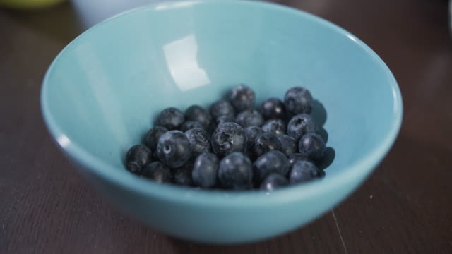 small bowls of blueberries - berry fruit stock videos & royalty-free footage