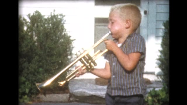 1960 small boy blows large trumpet - musical instrument stock videos & royalty-free footage