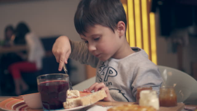 small boy eating pancake - preserve stock videos and b-roll footage