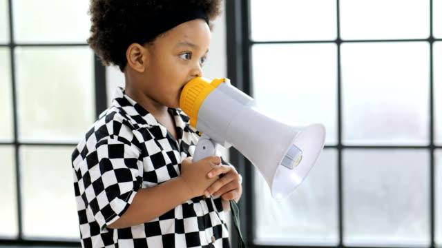 small boy shouting through a megaphone. - megaphone stock videos & royalty-free footage