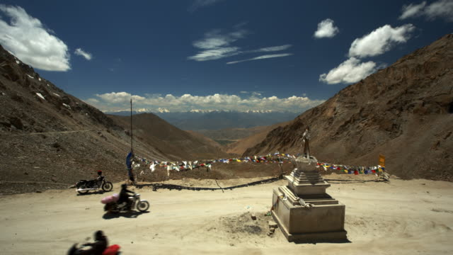 small buddhist stupa marks the peak of a high mountain pass road. - trade war stock videos & royalty-free footage