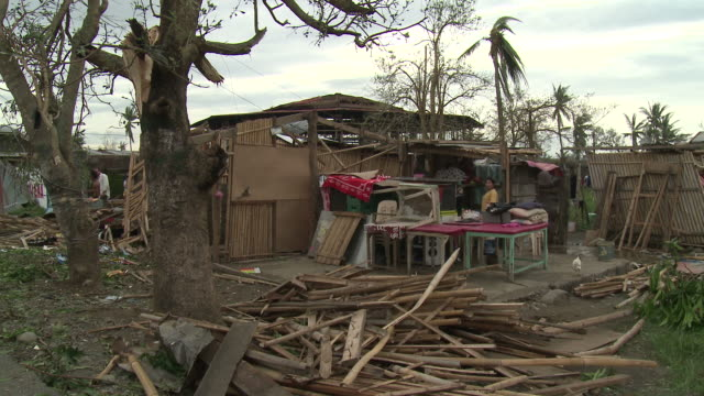 small buildings lie in ruins after typhoon megi or juan hit the philippines, ne luzon, philippines oct 2010 / audio - record breaking stock videos & royalty-free footage