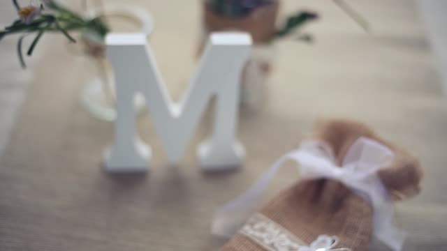 vidéos et rushes de small burlap cloth bag decorated with ribbons and a white butterfly - lettre de l'alphabet