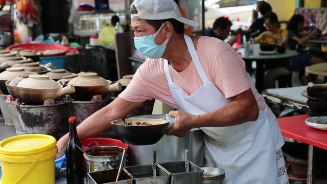 small business - claypot chicken rice - kuala lumpur stock videos & royalty-free footage