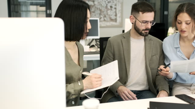 small business meeting, three people working together. - direttrice video stock e b–roll