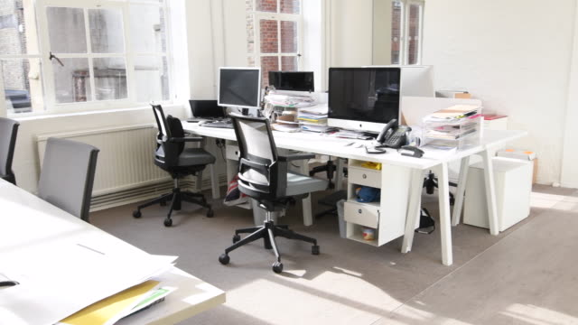 small business office with open plan workspace - office chair stock videos and b-roll footage