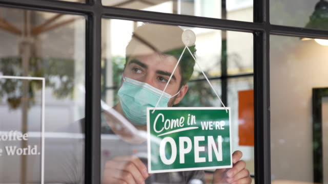 small business opening during covid-19 pandemic - shop sign stock videos & royalty-free footage