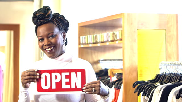 Small business owner, black woman in clothing store