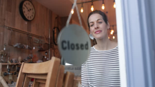 small business owner opening store - window display stock videos and b-roll footage