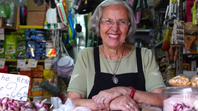 small business owner senior woman portrait - spanish culture stock videos & royalty-free footage