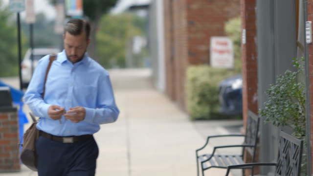 Small business owner walks to work in morning and unlocks restaurant