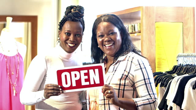 Small business owners, black women in clothing store