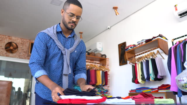 small business selling clothes - responsibility stock videos & royalty-free footage