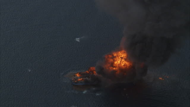 aerial, zi small cargo ship exploding on sea - burning stock videos & royalty-free footage