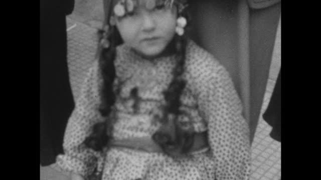 vídeos de stock e filmes b-roll de a small child dressed as a gypsy poses for the camera at carnival in buenes aires 1927. - estilo de vida alternativo