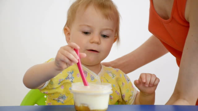 small child eating curd with fruit yogurt - baby boys stock videos and b-roll footage