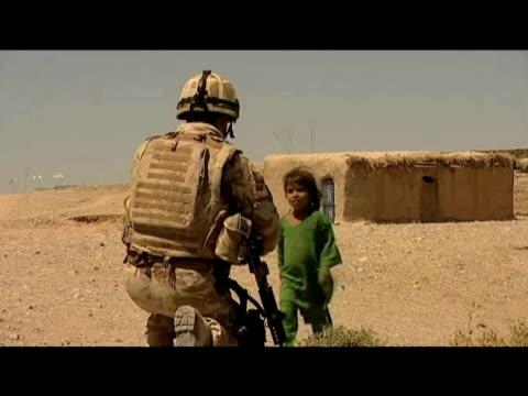 Small child walks towards British soldier 10 September 2009