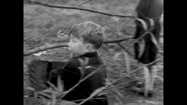 small children drag logs for bonfire; 1955 - log stock videos & royalty-free footage