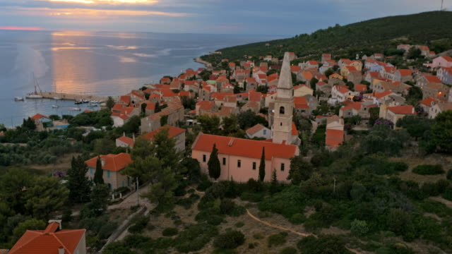 AERIAL Small coastal town at sunset