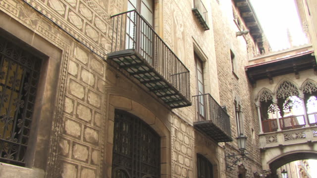 ms, la, pan, small crossing in carrer del bisbe, barri gotic, barcelona, spain - gothic quarter barcelona stock videos and b-roll footage