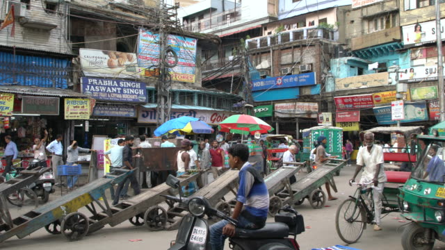 small crowded square in old delhi - city street sign stock videos and b-roll footage