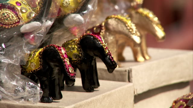 Small decorative elephants for sale in a Jaipur market. Available in HD