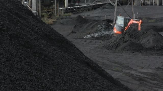 small digger moves mound of coal - coal mine stock videos and b-roll footage