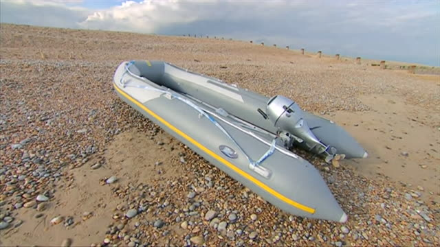 small dinghy abandoned on sussex beach by migrants who crossed channel into the uk removed by border force officials - english channel stock videos & royalty-free footage