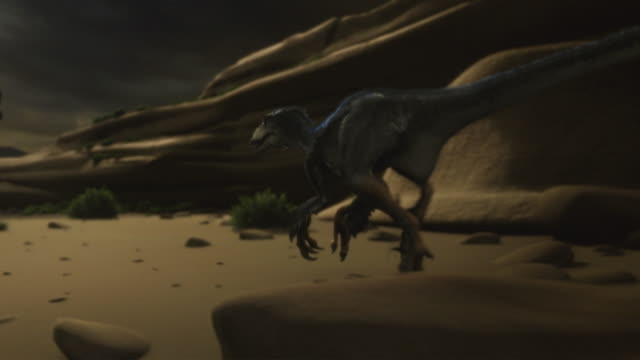 A small dinosaur creeps across a sandy plain, then feeds on the carcass of another dinosaur in a computer generated animation.