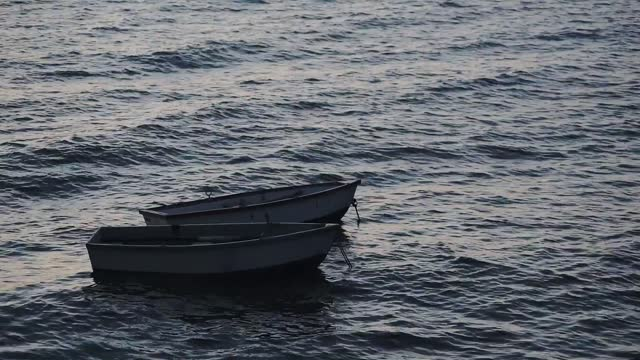 small empty boats anchored by the shore of guernsey - close up - anchored stock videos & royalty-free footage