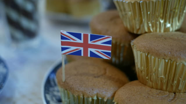 small England flag on cup cake  and chocolate waffle rolls